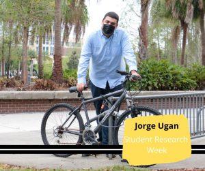 Jorge Ugan behind a bicycle