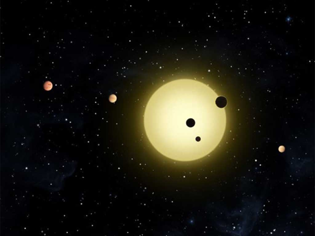 An artist's representation of Kepler-11, a small, cool star around which six planets orbit.